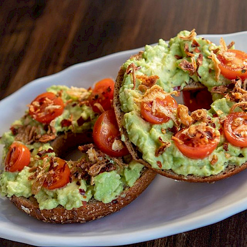 Plate of avocado toast on bagels